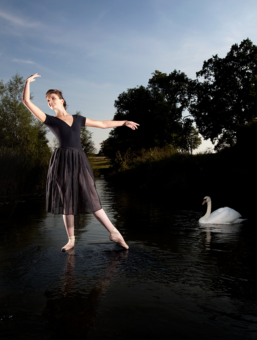 Ballet dancer portrait dancing on the surface of the River Avon in Warwickshire.