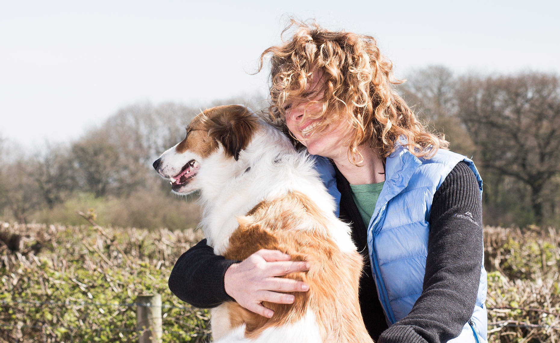 Close up portrait of Television presenter, Kate Humble with her Welsh sheepdog Teg.